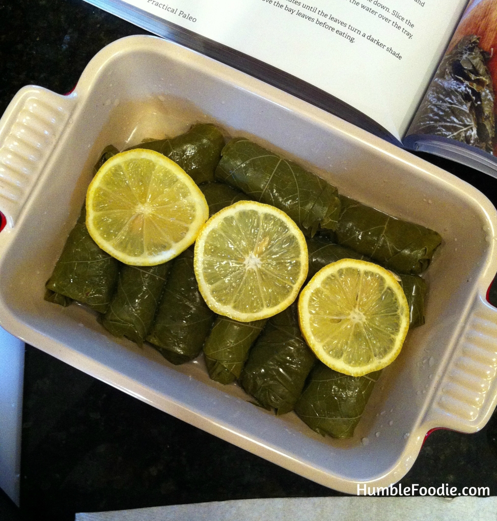 Pan of dolmas paleo stuffed grape leaves